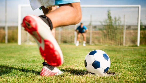 soccer player about to kick the ball