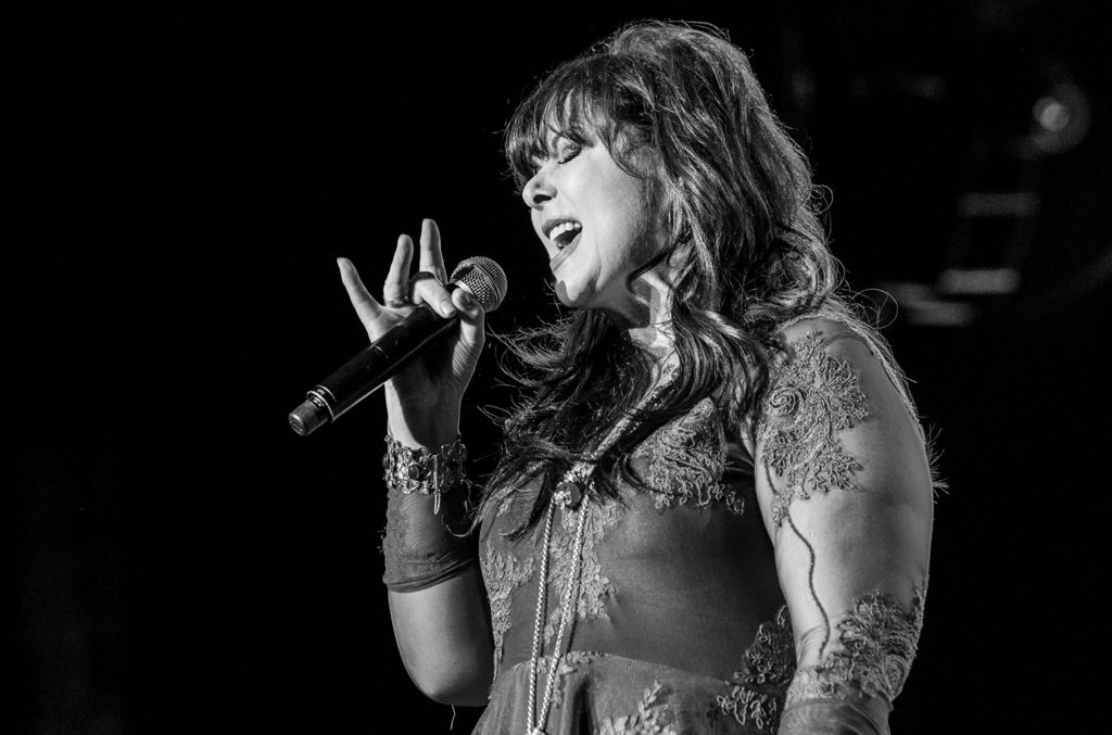 Ann Wilson of Heart on stage singing