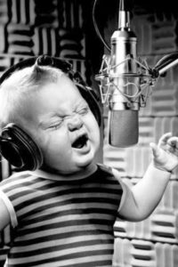 baby singing in front of microphone