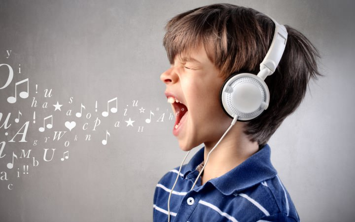 boy singing loudly with headphones on