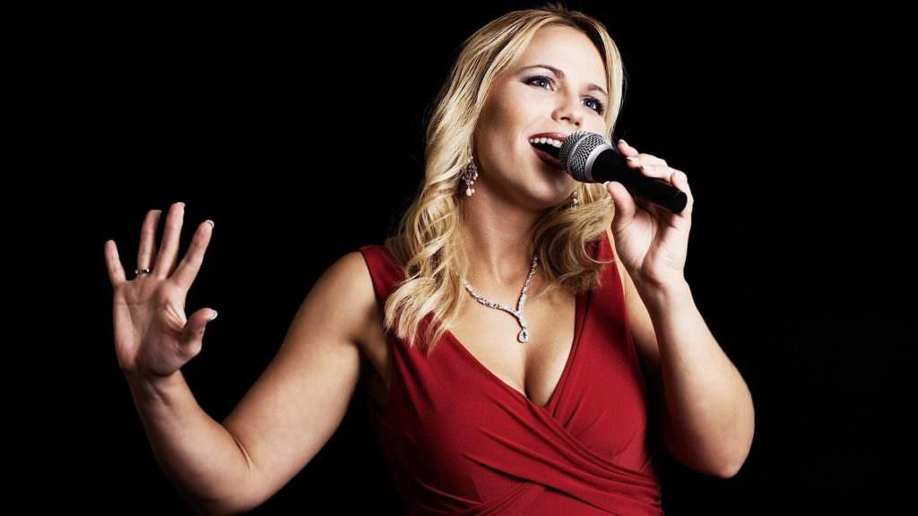 blonde woman singing