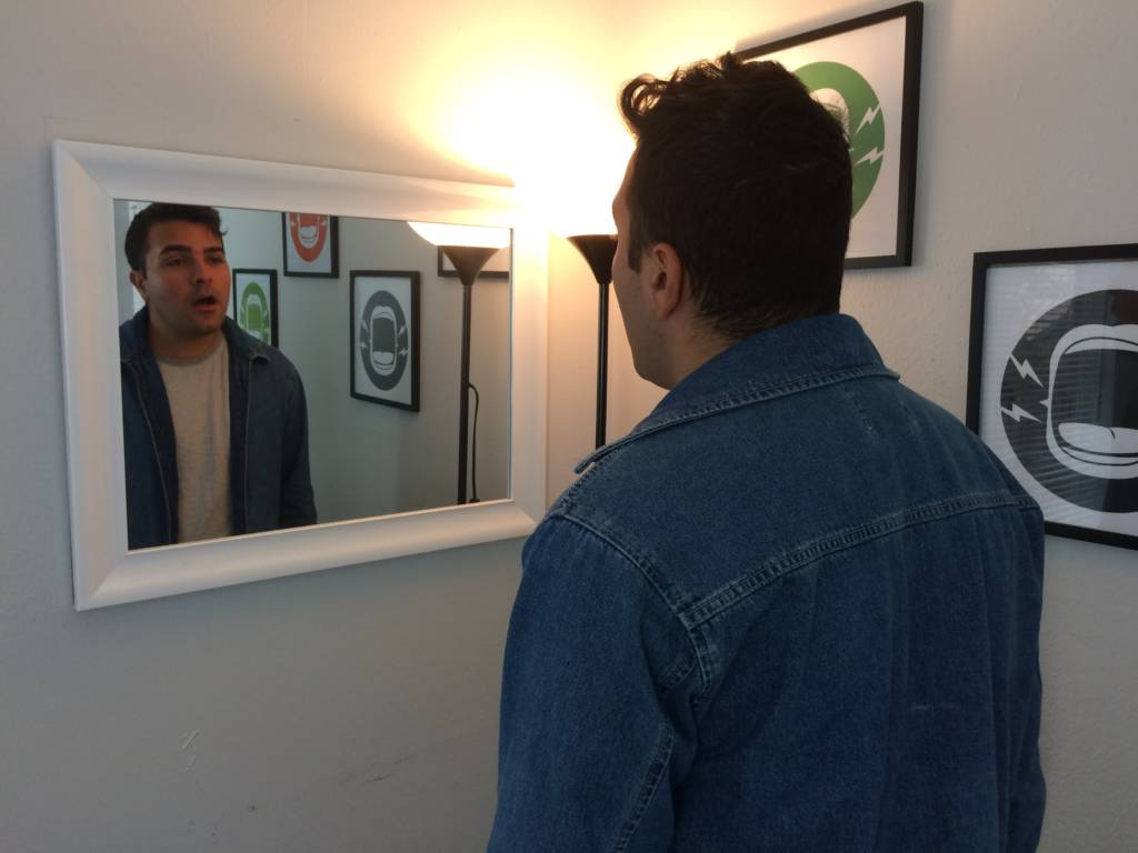 a man looking in the mirror