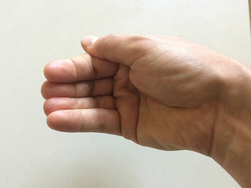 Hand with fingers curled in the shape of a bowl