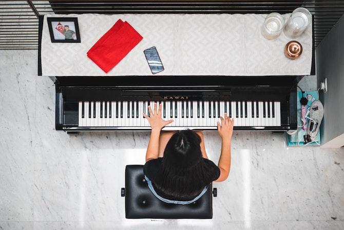 Young person playing Kawai piano